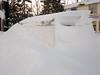 Van disappearing into the snow along Revillon Road in Moosonee.