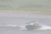 Taxi boat turning in heavy rain.