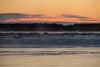 Sky before sunrise looking across the Moose River from Moosonee. Drifting snow over the sandbar.
