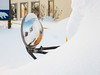 Mirror on a bus in the snow on Revillon Road.