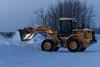 Piling snow along Revillon Road in Moosonee.
