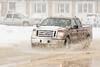 Slush and water on First Street in Moosonee.