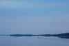 Canoe heads down the Moose River at Moosonee before sunrise.