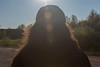 Denise Lantz backlit by the sun.