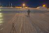 Snowmobile tracks up the Moose River shoreline.