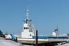 Barge Niska I in winter storage along the Moose River in Moosonee.