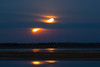 16 minute time exposure of the moon rising across the Moose River from Moosonee. During the exposure the moon passed behind some clouds.