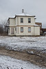 Old Roman Catholic Rectory in Moosonee. Former rectory in background.