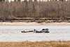 Small barge carrying truck to Moose Factory.