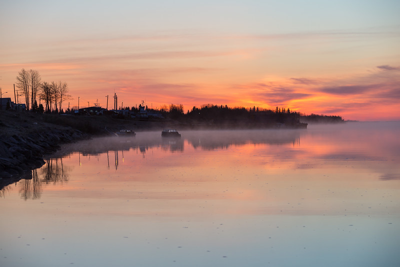 Moose River shoreline looking down the river before sunrise. Low fog drifting.