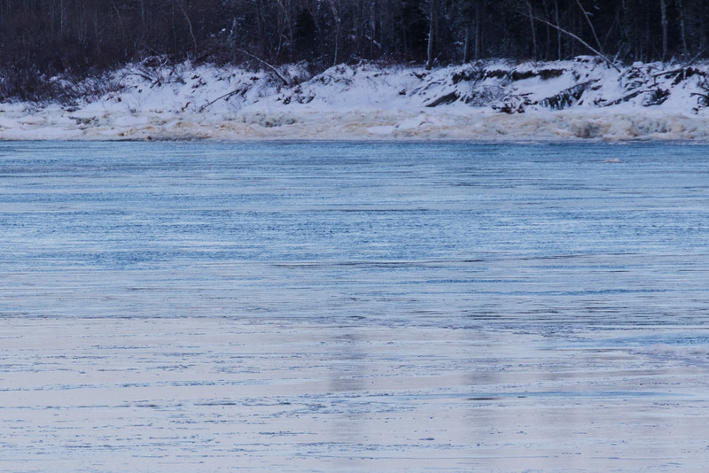 Water flowing along shore of Butler Island. Ice in foreground. 2016 December 9th.