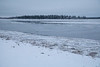 Looking across the Moose River towards Butler Island. Ice along shoreline.