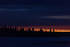 Looking across the Moose River from Moosonee before sunrise, a thin line of colour along the horizon. 2016 November 6th. Noise reduction luminance 20 applied.