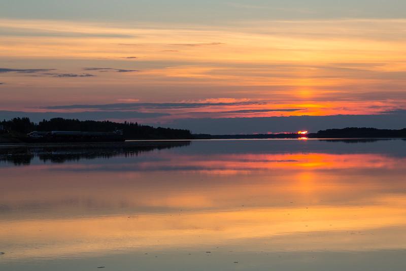 Sunrise at Moosonee looking down the Moose River. Dark exposure. HDR sequence shot.