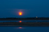 Moon rising across the Moose River with fireworks from Moose Factory. 2016 May 22nd.