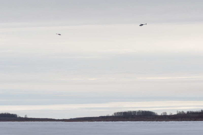 Helicopters down the Moose River from Moosonee.