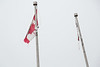 Ontario and Canadian flags at train station in Moosonee.