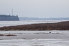 Lookingup the Moose River from Moosonee. Might be breakup by the hydro towers.