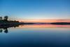 Looking down Moose River shoreline in Moosonee before sunrise 2016 July 31st. HDR sequence shot.