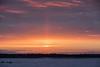 Almost sunrise. Sun pillar fading across the river.