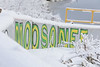 Part of the Welcome to Moosonee sign.