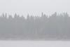 Dreary morning, light rain looking across the Moose River from Moosonee.