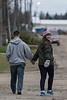 David Hunter and Mercedes walking on Revillon Road in Moosonee.