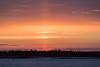 Sun pillar just before sunrise.