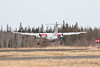 Heat distortion blurs Air Creebec DHC-8 C-FCLS as it takes off from Moosonee.