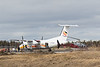 Air Creebec DHC-8 C-FCLS on the ground in Moosonee near helicopter C-GQNS.