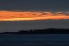 Looking down the Moose river before sunrise. Streak of brightness low in the sky.