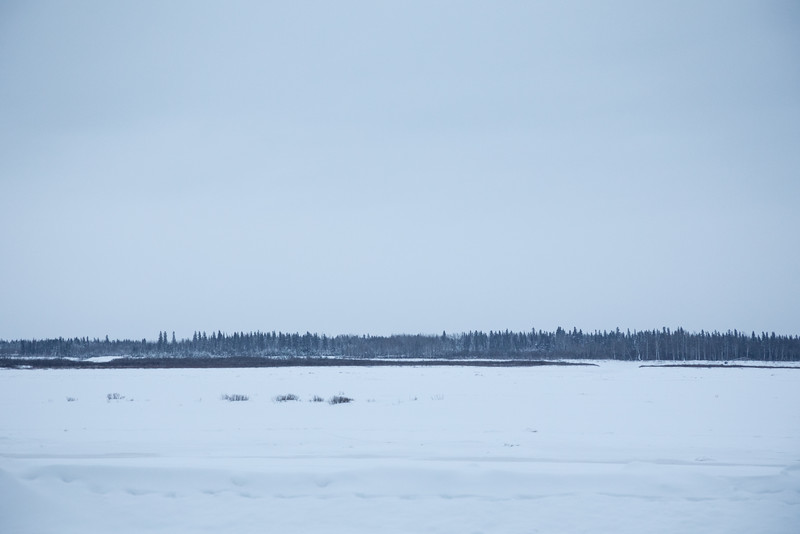 Looking across the Moose River before sunset on a dull and cloudy morning in Moosonee 2016 December 29th.
