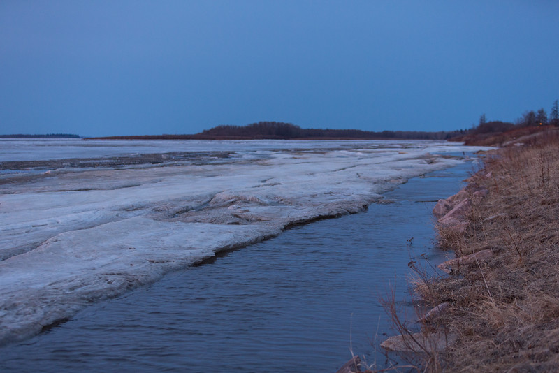 Water along the edge of the ice on the Moose River. Looking up river 2016 May 6th.