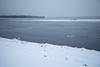 Looking across the Moose River towards south end of Butler Island. Ice sheets floating down the river.
