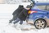 Good Samaritans give a push to motorist.