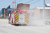 Moosonee Fire Truck Pumper 2 turning from First Street on to Bay Road.