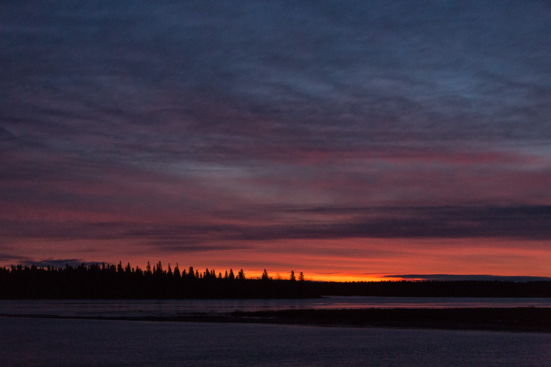 Sky before sunrise looking across the Moose River from Moosonee on a dark morning 2016 October 27th. Moderately high ISO.