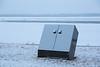 Bear proof garbage can along the Moose River in Moosonee as frsh snow falls 2016 April 30th.