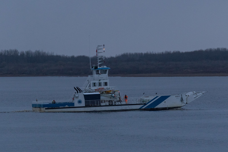 Barge Niska I heading to Moose Factory on a cloudy morning.