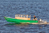 Taxi boat heading to Moose Factory from Moosonee.