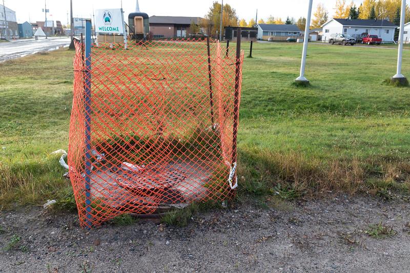 Decaying manhole cover at Moosonee train station.