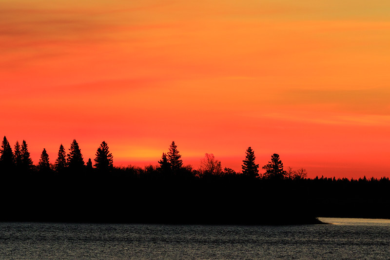 Red and yellow sky over Butler Island before sunrise.