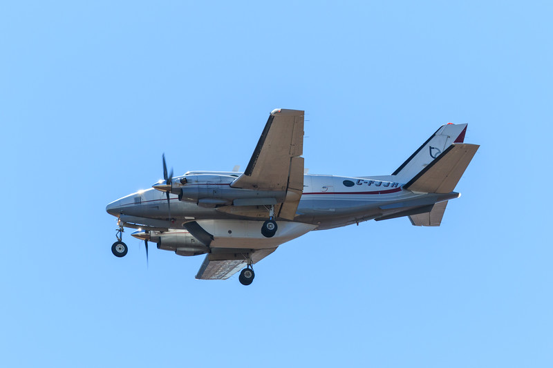 Thunder Airlines Beech A100 C-FJJH coming to land at Moosonee. Backlit