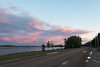 Clouds over the Moose River at sunset at Moosonee.