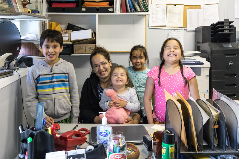 Heather Nootchtai and her children visiting at Keewaytinok Native Legal Services Where Heather's desk used to be when she worked as receptionist at age 16.