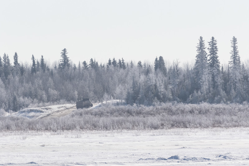 Dump truck driving up onto Moose Factory Island.