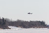 ORNGE ambulance helicopter C-GYNZ returning to base in Moosonee from Moose Factory.
