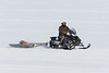 Snowmobile with sled on the Moose River.