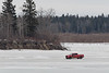 Red pickup truck driving on the Moose River by south end of Butler Island 2017 March 27th.