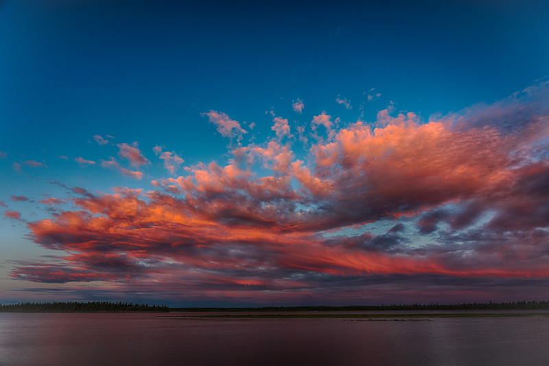 Clouds over the Moose River at sunset at Moosonee. Psudeo HDR from single exposure. DARK.